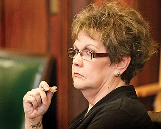 Lori Lamb, former office manager at Morris Drain Service Inc., awaits sentencing for theft from that company Tuesday in Mahoning County Common Pleas Court. Judge Lou A. D'Apolito put her on probation for five years and ordered her to make $124,000 in restitution.