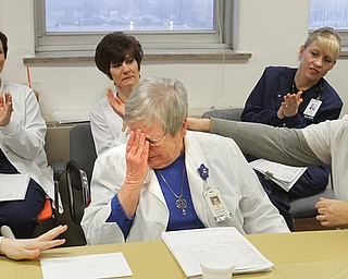 """Pat """"Pinky"""" Pinkerton of Salem is overcome with emotion at a surprise celebration at St. Elizabeth Health Center, Youngstown, for her 50 years with the hospital. She gets an encouraging arm from registered nurse Donna Flauto."""