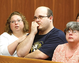 Shawn Tedesco, Teddy's father, is comforted by an unidentified family friend, left, as the boy's grandmother, Sara Foltz, sits at right during Wednesday's initial Struthers Municipal Court appearance of Zaryl G. Bush, 43, who is charged with rape and murder in the boy's death.