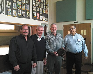 Struthers Rotarians Dan Becker, second from left, and Tom Baringer, right, welcome new members, Chuck Campbell, left, and Ernie Ciarniello at a recent meeting. Campbell retired from Schwebel Baking Co. after 32 years in sales and supervision and now works for Becker Funeral Homes. Ciarniello worked for Becdir Construction and JET Excavating and in 2005 took over Ernie's Barber Shop for his father.