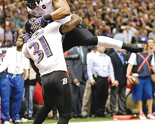 Baltimore Ravens linebacker Ray Lewis (52) and safety Bernard Pollard (31) celebrate an incomplete pass thrown by San Francisco 49ers quarterback Colin Kaepernick late in Sunday's Super Bowl.