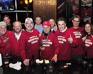2/2/13 New Orleans LA.-NFL Youngstown Businessman Bruce Zoldan meets a group from Youngstown Ohio in the San Franciso 49er's hotel lobby bar and passes out special Youngstown Ohio SF49er's Tshirts. Included in the group is Greg Strollo, Mike Bruno,Jeff Chrystal, and Sue and Ron Yarab all from Youngstown. Photo©Suzi Altman
