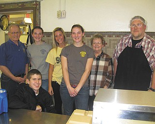 Fitch Interact members recently joined the Austintown Rotary and served the evening meal at the Rescue Mission of Mahoning Valley, a monthly service project for both groups. Kneeling is Colin Wilson, and standing from left are Tony Cebriak, Amanda Choma, Madison Hefner, Jaclynn Choma, Judy Cebriak and Wayne Miller a member of the Rescue Mission staff.