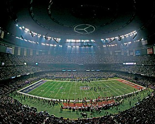 Fans and members of the Baltimore Ravens and San Francisco 49ers wait for power to return in the Superdome in New Orleans on Sunday during an outage in the second half of Super Bowl XLVII.