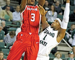 Youngstown State's Kendrick Perry (3) attempts a jump shot against Cleveland State defender Sebastian Douglas (1) during the first half of Tuesday's game at Wolstein Center in Cleveland. The Penguins came up short, losing 66-60.