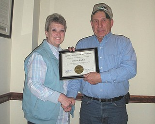 Sharon Cope, president of Columbiana County Fair Board, presents a certificate of recognition to Delmar Karlen of Salem at a recent meeting. Every year individuals from across the state are recognized for their outstanding support of local fairs during ceremonies at the Ohio Fairs Convention in Columbus. Karlen represented Columbiana County Fair with this honor for his continued devotion and support.