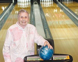 Jean Guarnieri, of Liberty, a senior league bowler at Holiday Bowl in Struthers, rolled a 100 on Wednesday, which was her 100th birthday. A plaque, cake and cards also marked the occasion.