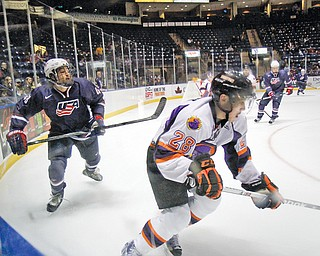 Phantoms defenseman Kale Bennett (28) and Team USA's Sonny Milano (48) compete during a recent game at the Covelli Centre. Low attendance will be a factor in whether the team returns for a fifth season.
