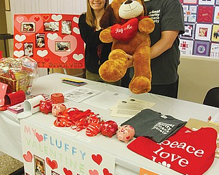 Caitlyn Hicks, graduate assistant with Youngstown State University's Emerging Leaders Program, and Jason Cooke, vice president of Animal Charities Humane Society, are accepting donations for the third annual My  Fluffy Valentine on the second floor of YSU's Kilcawley Center from 10 a.m. to 2 p.m. daily through Friday .