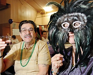 Mason Balestra and Flo Leonelli, both of Youngstown, enjoy the Mardi Gras party at Christ Our Savior Parish in Struthers. The parish hosted the event Monday for some 130 members.