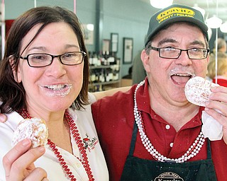 Aundrea Cika, Polish Youngstown director, and Jack Kravitz, owner of Kravitz Deli in Liberty, enjoy a paczki on Mardi Gras. The Fat Tuesday event was marked by with a Polish celebration at the traditional Jewish eatery.