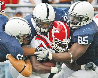 Youngstown State running back Adaris Bellamy is swarmed by Penn State defenders. Late Tuesday, Wisconsin athletic director Barry Alvarez said on the radio that the Big Ten will stop scheduling games against FCS teams, a move that could cost YSU hundreds of thousands of dollars a year.