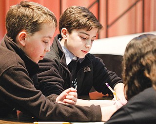 Willowcreek Learning Center students, from left, Ethan Ball, Jacob Snyder and Grace Haddad participate in the Mathbowl, one of the events Thursday at MATHCOUNTS in the Chestnut Room of Youngstown State University's Kilcawley Center.