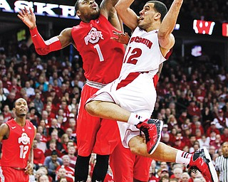 Wisconsin's Traevon Jackson (12) shoots against Ohio State's Deshaun Thomas during the second half of a game Sunday in Madison, Wis.