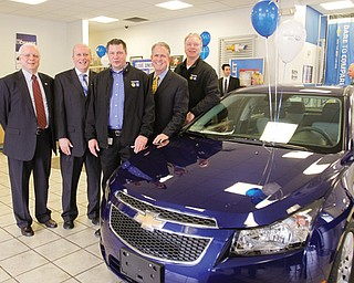 United Way officials and other leaders of the 2012 United Way of Youngstown and the Mahoning Valley campaign stand with the Chevrolet Cruze donated as a campaign incentive. From left, Thomas J. Krysiek, Trumbull County United Way president and chief professional officer; Robert Hannon, Youngstown/Mahoning Valley United Way president; David Green, president of United Auto Workers Local 1714 at General Motors Lordstown; Greg Greenwood, owner of Greenwood Chevrolet; and Glenn Johnson, president of UAW Local 1112 at GM Lordstown.