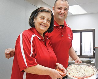 Tina Cocca, left, and her son, Steve, who oversees the Cocca's Pizza chain, recently moved their flagship location to the former New York Music building in Boardman. The new quarters are bigger, with eight ovens that can cook 48 pizzas every 15 minutes. There also are menu additions, such as panini and authentic Italian sandwiches. The company hired 10 new employees.