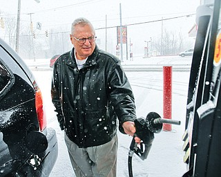 Ron Catale of Poland fills up at Big Apple Supermarket at Albert Street and McGuffey Road on Youngstown's East Side, which had gas 12 cents lower than the Northeast Ohio average of $3.81 per gallon. Catale is among many Mahoning Valley residents feeling a pinch at the pump. According to AAA, gas prices have jumped nearly 45 cents in the past month.
