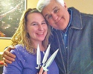 Amber Bohac gets a hug from Jay Leno. Bohac got a visit from the talk-show host and demonstrated her knife-throwing skills for him.