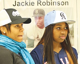 Choffin Career and Technical Center seniors, above from left, Delana Robinson and Charisse Brown, listen to the Black History program Wednesday at the school. W. James Cobbin, right, was the featured speaker. Cobbin, a city resident, played baseball in the American Negro League in the 1950s.