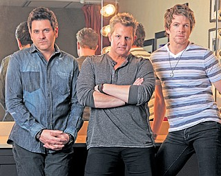 Rascal Flatts is Jay Demarcus, left, Gary Levox and Joe Don Rooney.
