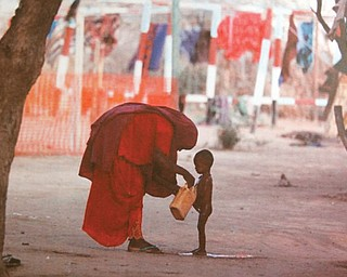 This photo is in a display set up by People Fighting Famine depicting a refugee camp in Africa, where millions  fled to find relief from a drought. The grass-roots group is sponsoring prayer and vigils on Federal Street downtown and presentations at First Unitarian Universalist Church on Elm Street on Youngstown's North Side today and Saturday.