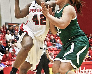 Youngstown State senior Brandi Brown (42) shoots against Cleveland State defender Nafeshia Holifield (32) during the first half of their game Thursday at YSU's Beeghly Center. Brown scored a season-high 33 points and grabbed 11 rebounds to help lift the Penguins over the Vikings, 73-69.