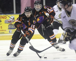 William D Lewis The Vindicator Phantoms Zach Evancho(16) and Kyle Connor(18) move the puck during 2-23-13 game with Lumberjacks.