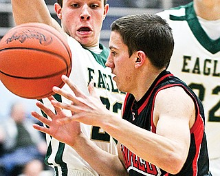 Canfield's Cole Pryjma (2) moves around GlenOak's Mike Hronek (23) during Monday's Division I tournament game in Alliance.