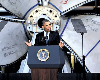 Standing in front of a ship propeller, President Barack Obama speaks about automatic defense-budget cuts on Tuesday at Newport News Shipbuilding in Newport News, Va.