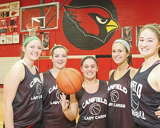 The Canfield girls basketball team — led by seniors, from left, Kayla Barko, Abby Baker Paige Baker, Allie Pavlansky and Sabrina Magapora — is ready to face Struthers today in a Division II district semifinal at Austintown High School.