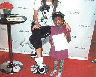 """Marcilee Kinerman, 6, of Alpharetta, Ga., beams while meeting her favorite star from the Disney Channel: Zendaya, who plays Rocky Blue on """"Shake It Up."""" Marcilee is the granddaughter of Randolph Jones of Youngstown."""