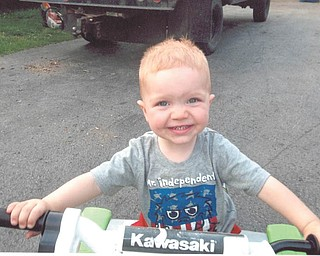 """Revved up and ready to go is 2-year-old Landon Black of McDonald. This photo was sent in by his nana, Kathy Black, who says, """"His smile melts my heart!"""""""