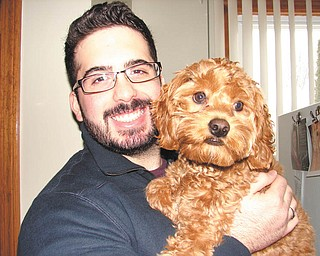 """This photo of Daniel Morris and his puppy Chloe keeps his mother, Darlene Morris, motivated to know her son is doing well as he gets his degree in chemistry from Akron University. Darlene says she always tells Daniel """"his smile is worth a million bucks!"""""""