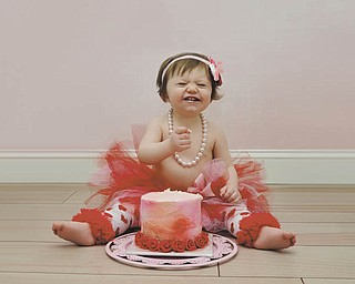 Pretty in pink, red and pearls is Skylar Sheridan of Austintown, who is celebrating her first birthday here. Photo sent in by Allison McClain.