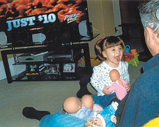 """Adyson Baxten, 3, of Hubbard, is delighted to play dolls with her """"Poppy,"""" David Mink of Howland. Photo sent in by Mary Baxten of Girard."""
