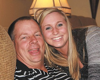 Taylor Smith and her dad, Paul Smith of Butler, Pa., show their winsome grins. Photo sent in by Jackie Cannatti of Poland.