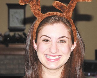 Justine Cannatti of Columbus was glad to be home in Poland for Christmas. Photo sent in by Jackie Cannatti of Poland.