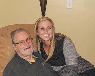 Here's Taylor Smith with her grandpa, Jack Sodeman, both of Butler, Pa. They were celebrating Christmas at the Poland home of Jackie Cannatti, who sent in this photo.