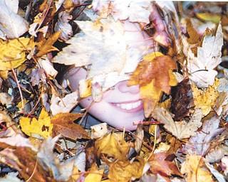 Leanna Hartsough in the leaves. Photo sent in by Lana VanAuker of Canfield.