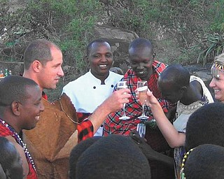 Kim and Mike Porter toast at an African wedding in Africa. Kim is the granddaughter of Frank Blanco of Boardman.