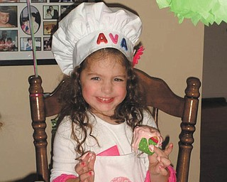 """Ava Acevedo of Boardman is all smiles at her """"baking party"""" celebrating her 4th birthday in November. Her parents are Rob and Toni Acevedo."""