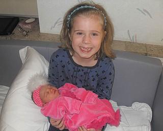McKenna Sweeney of Boardman holds newborn Giada Musser of Canfield. Photo sent in by Marnee Sweeney.