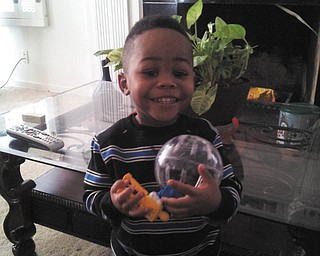 All excited over his new pet is Cameron Kelley of Youngstown. Photo sent in by Genita Johnson.