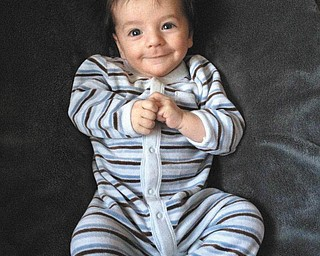 Lorenzo Michael Testa of Boardman was two months old when he gave big smiles to his parents, Angela and Michael, at Christmas time.