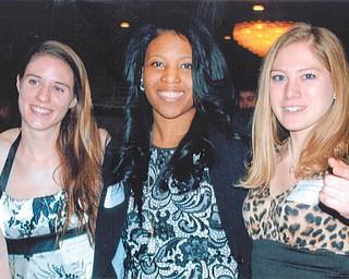 Laura Kosiorek, coach Katrina Brumfield and Leanna Hartsough smile over a successful YSU track season. Photo by Lana VanAuker of Canfield.