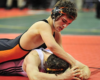 Howland's David Brian-Whisler applies pressure to the head of Hillsboro's Kordell Ford.
