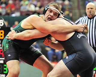 West Branch's Logan Sharp grapples with Carrollton's Austin Bentley.