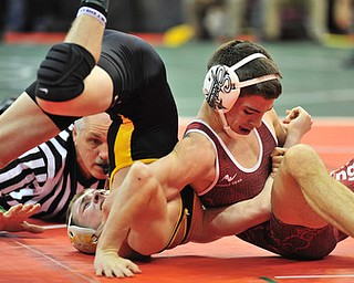 Boardman's Nick Mancini attempts to pin Oregon Clay's Jared Davis.