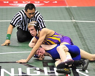 Poland's Dante Ginnetti attempts to avoid being pinned by Eaton's Michael May.