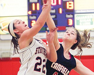 Struthers' Brittaney Zupko (22) tries to shoot over Canfield's Sabrina Mangapora (44) during the Division II district semifinal Thursday at Austintown Fitch High School. The Cardinals bested the Wildcats, 61-54.